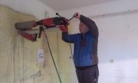 Izdelava preboja za napo in odtoke,obnova starejše kraške hiše